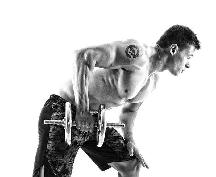 Full length photo of young attractive muscular man workout with